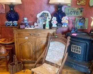 Antiques. folding antique rocking chair, working cast iron stove, pair of cobalt lamps. small size buffet server with fold out top