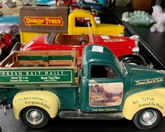 large collection of diecast trucks and cars