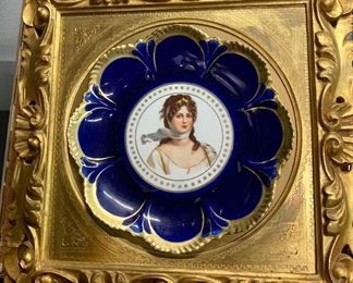 20th century Lady Plate porcelain with gold and enamel decorations framed in wood gilt frame