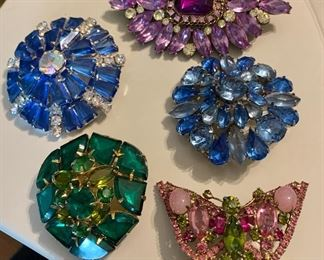 large selection of vintage rhinestone brooches