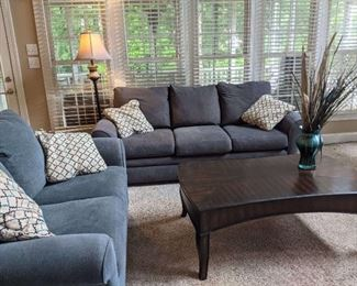 Lazy Boy sofa and love seat. Coffee table and floor lamp.