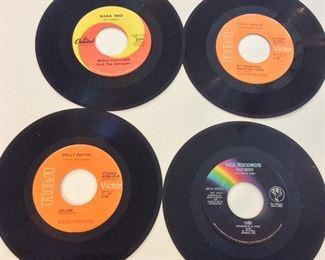 Over 1,100 vinyl 45 RPM records. Dolly Parton Jolene.