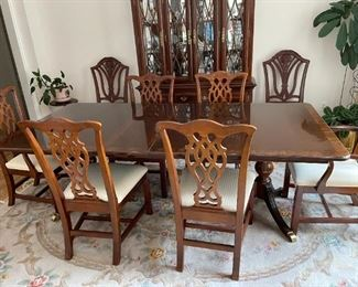 . . . I love this Duncan Pfyfe-style dining room set