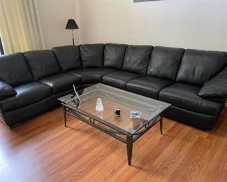 . . . I love this leather sectional -- fantastic -- with nice glass coffee table