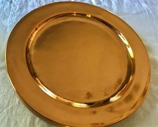"""$40 - Set of 8 copper toned plastic chargers.  Each 11"""" diam."""