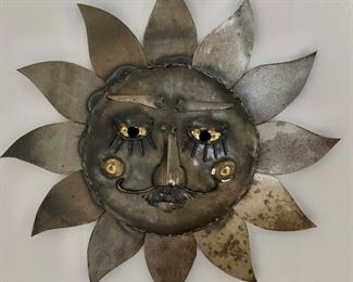 "$50 Metal sun sculpture #2  12"" diam, 2"" D."