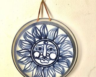 """$40 - Blue and white painted sun, signed - 8"""" diam."""