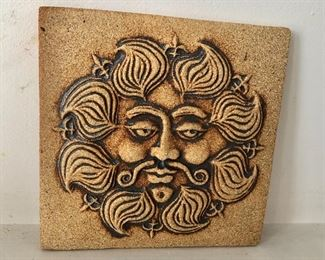 """$75  Signed ceramic tile face with mustache.  8"""" H x 8"""" W."""