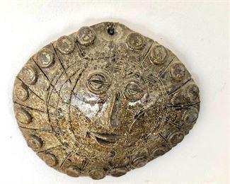 "$40 Ceramic sun form, signed DT Keyes.  4.5"" H x 5.5"" W."