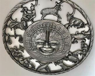 "$40 - Sundial sun metal sculpture.  11"" diam."