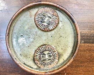 "$40 - Ceramic dish with two sun faces.  6.5"" diam, 1"" deep."