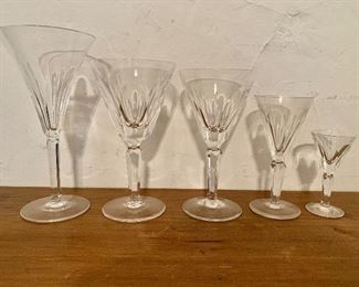 """Waterford stemmed glasses. Left to right: 4 red wine each 8"""" H, 4"""" diam. 5 large white wine each 7"""" H, 4"""" diam. 6 small white wine each 6.5"""" H, 3.5"""" diam.  10 sherry each 5.5"""" H, 2.5"""" diam.  11 cordial each 3.75"""" H, 1.75"""" diam."""