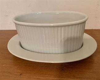 "$30. Dansk sauce or gravy bowl and saucer. Bowl: 6.5"" L, 4"" W, 3"" H. Saucer: 8.75"" L, 6"" W."