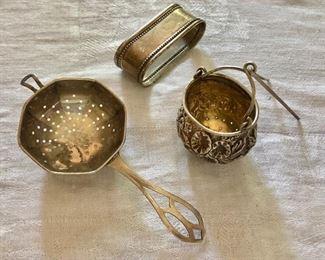 """$30 ea/napkin ring $20 - Sterling silver tea strainer with handle,  SOLD $20 napkin ring, basket-shaped tea strainer SOLD . Napkin holder 2.5"""" L."""