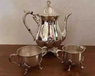 "$40 Silver plate coffee pot, $40 pair silver plate creamer and sugar with marks.  Coffee pot 9.5"" H, 8.5"" W; creamer 3"" diam, 2.5"" H; sugar bowl 3.25"" diam."
