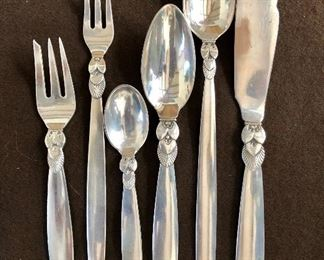"""Detail of set - 12 of each item except 7 ice cream or sorbet spoons .  Fish knife 7.75"""" long for scale."""