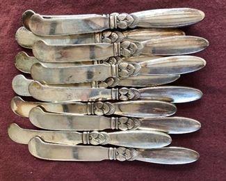 "$720 Set of 12 Georg Jensen Cactus pattern sterling silver butter knives. Each 6"" long."