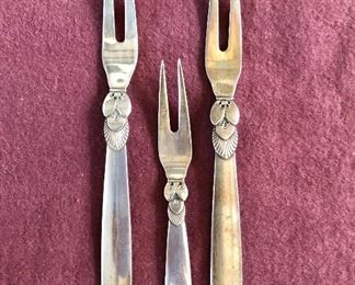 """$95 each, middle smaller one $60 Georg Jensen Cactus (Kaktus) pattern sterling silver condiment forks 6""""L to 4.5"""" L. Left one SOLD, middle one SOLD"""