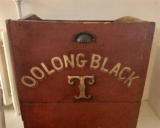 "$395  Vintage stencil red washed wood ""Oolong Black Tea"" storage bin.  30"" H, 23.5"" W, 19.5"" D."
