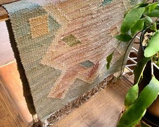 """$150.  Woven rug with fringe #1 - 77"""" L x 34.5"""" W."""