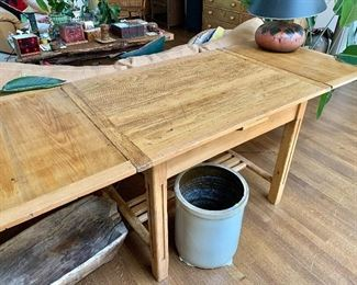 """$795 - Vintage table; leaves are stored under center piece -  31.5"""" H, 81"""" L (including two 18.5"""" leaves), 31.25"""" D."""