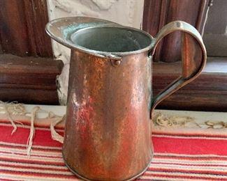 """$45 - Copper pitcher.   8"""" H."""