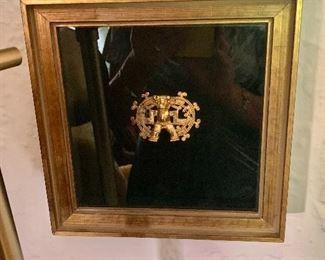"$75  Gold tone primitive design framed.   8"" H x 8"" W."