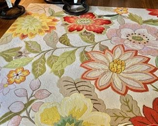 """$350  Floral woven carpet, minor stains and pulls.  125.75"""" x 96.25""""."""