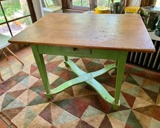 """$650  Vintage work table with single drawer and painted green base  31"""" H, 43.5"""" L, 32.25"""" W."""
