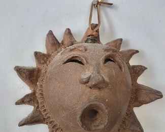 $65 Terracotta sun hanging
