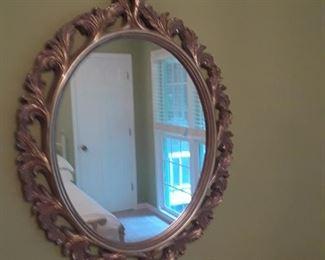 Oval mirror in gold leaf frame