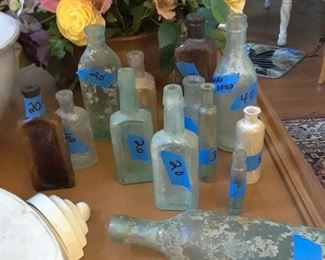 Antique bottle collection. One early Coca Cola bottles and 3 early Savannah Georgia bottles. Some rare and unusual