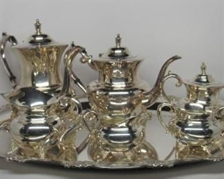 """Located in: Chattanooga, TN MFG Gorham Silver Company Sterling Silver Coffee & Tea Service Set 6 Piece Est. Appraisal Value - $10,900.00 * See Web Link* Includes: 8"""" Coffee Pot, 8"""" Teapot, 6"""" Covered Sugar, 5"""" Creamer, 3"""" Creamer, 3"""" Double Handled Open Sugar, & 25"""" Handle to Handle Waiter Total Sterling Silver Weight - 5.2 lbs *Tray is Nickel Silver* *See Web Link* *Serving Set is Sterling Silver* * See Web Link* *Sold As Is Where Is*"""