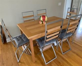 This table and chair set is from Italy - the ends pull out to extend, and believe it or not, these cool chairs are folding chairs.  It's a very interesting and functional set that goes very well with a modern or traditional decor!
