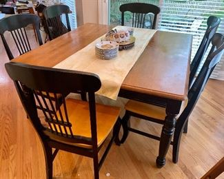 This is a terrific kitchen table set with six chairs - the table is square, the leaf can be removed to be a narrow table should your kitchen be less roomy.