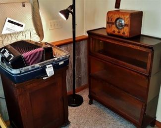 Antique Franklin sewing machine, accordion, Zenith radio, and barristers cabinet