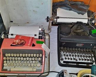Vintage typewriters: 1960s pink Corona; 1930s Royal