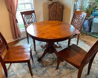Dining table with 1 leaf and 4 chairs