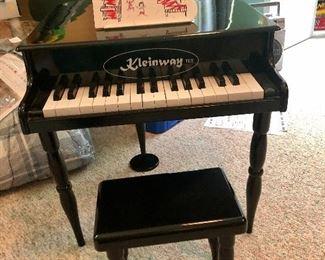 Child's Kleinway black baby grand piano