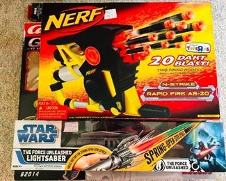 """Nerf Dart Blaster and a new in box Star Wars """"The Force Unleased"""" Lightsaber"""