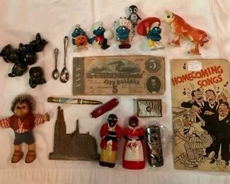 Upper left corner are small pottery pieces mini pitchers, and crocks, confederate money,  Smurfs , cloisonné' lighter cover and more