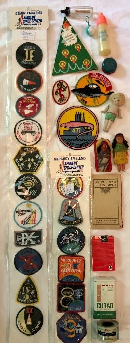 Vintage! Kennedy Space Center emblems, patches, baby bottles/toy, small Indian toy dolls, china doll, first aid ...