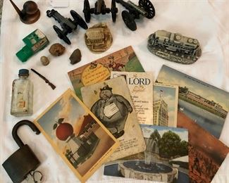 Vintage postcards, lock, small collectible cannons, old bottle...