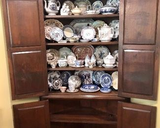 1700's to 1800's Transferware, nice corner cupboard hand cut dental mold at top.