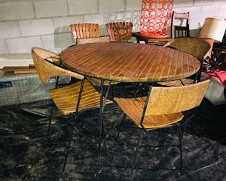 Very cool mid-century modern table with 4 chairs, tool box, orange table....