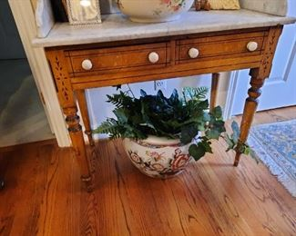 . . . another early piece with marble top and Eastlake carvings