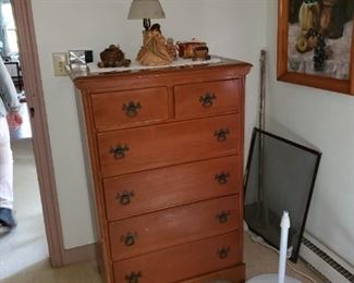chests of drawers, lamps, framed art