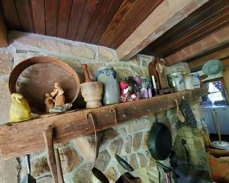 various antique crocks, sifters, mortar and pestle, clock etc