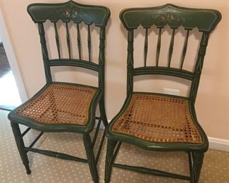 Matching painted cane chairs.
