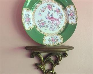 Decorative plates on sconces.